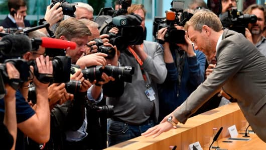 The chairman of Germany's Free democratic party FDP Christian Lindner faces photographers and cameramen as he arrives for a press conference on Sepbember 25, 2017, in Berlin one day after general elections. The pro-business and liberal Free Democratic Party (FDP) scored a 10.7- percent comeback after crashing out of parliament four years ago.