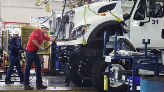 Employees work at the assembly line of International brand commercial trucks, owned by Navistar, at the manufacturing plant in Escobedo, on the outskirts of Monterrey, Mexico, June 29, 2017.