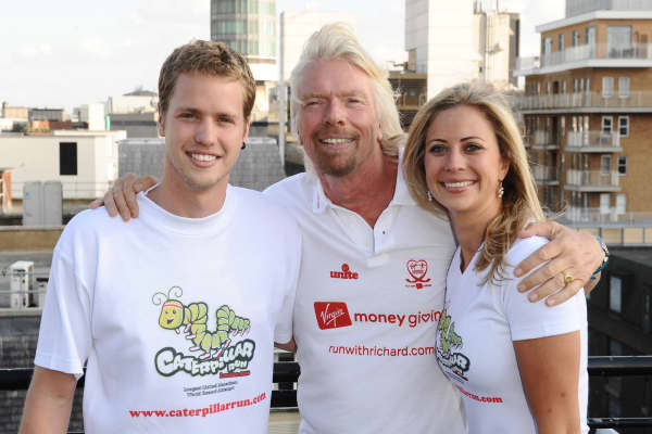 Holly and Sam Branson with their father Richard Branson in central London.
