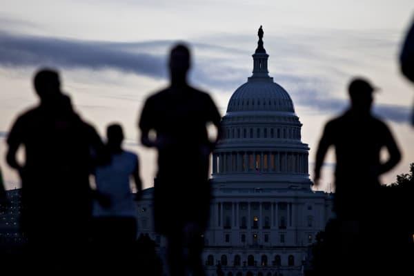 Runners jog near the U.S. Capitol in Washington, D.C.
