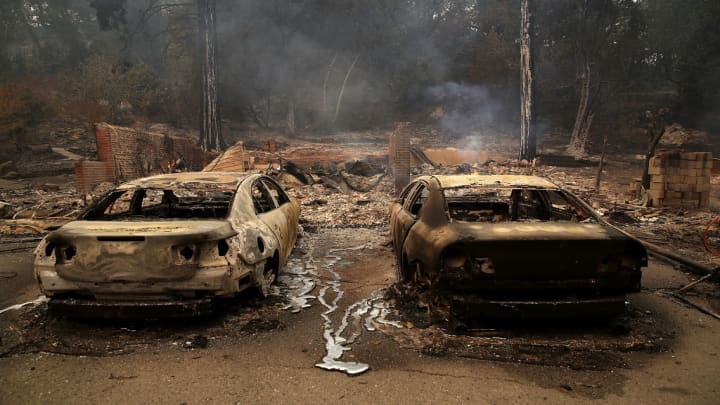 Burned cars sit idle after an out of control wildfire moved through the area on October 9, 2017 in Glen Ellen, California.