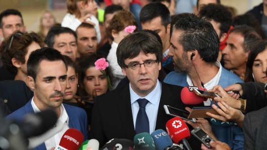 : Catalonia President Carles Puigdemont speaks to the medai after failing to vote in the referendum because of the Spanish police closing his polling station on October 1, 2017 in Sant Julia de Ramis, Spain. More than five million eligible Catalan voters are estimated to visit 2,315 polling stations today for Catalonia's referendum on independence from Spain. The Spanish government in Madrid has declared the vote illegal and undemocratic.