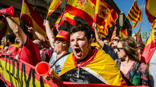 A young man shouts slogans at the head of the demonstration. Massive demonstration in Barcelona in defense of the unity of Spain. Nearly a million people have joined the call of Catalan Civil Society for the defense of the unity of Spain as a counterweight to the sovereigntists movements.