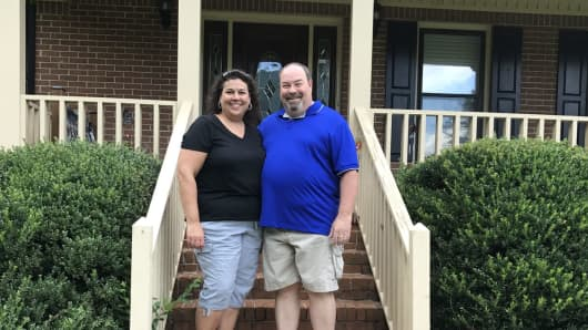 Janet and Jeff Swaney in front of their Atlanta area home
