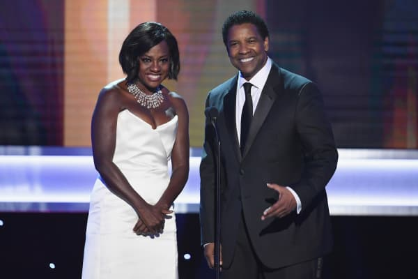 Actors Viola Davis and Denzel Washington speak onstage during The 23rd Annual Screen Actors Guild Awards