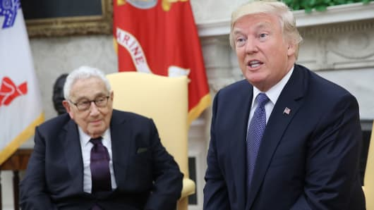 President Donald Trump meets with former U.S. Secretary of State Henry Kissinger in the Oval Office