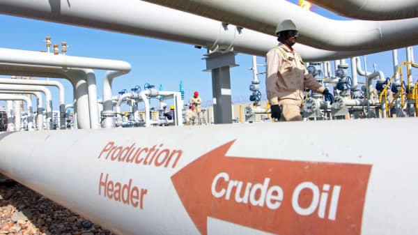 People work at the Halfaya oilfield in Amara, southeast of Baghdad.