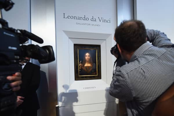 Christie's unveils Leonardo da Vinci's 'Salvator Mundi' (pictured) with Andy Warhol's 'Sixty Last Suppers' at Christie's New York on October 10, 2017 in New York City.