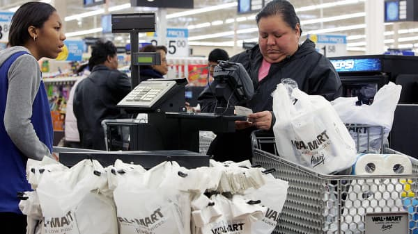 A shopper checks her receipt after shopping at Wal-Mart store in Evergreen Park, Illinois.