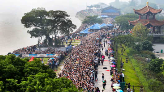Tourists view the Qiantang River Tide at Haining during the National Day holiday on Oct. 7, 2017 in Jiaxing, Zhejiang Province, China. Domestic travel destinations were popular among Chinese tourists during the Golden Week holiday this year.