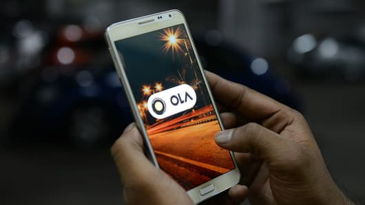 The Ola app displayed on a smartphone.