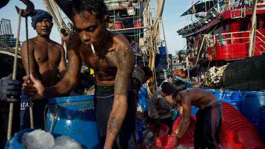 Migrant workers on a docked fishing boat on Aug. 8, 2014 in Phuket, Thailand, where slavery is common for those smuggled into the country.