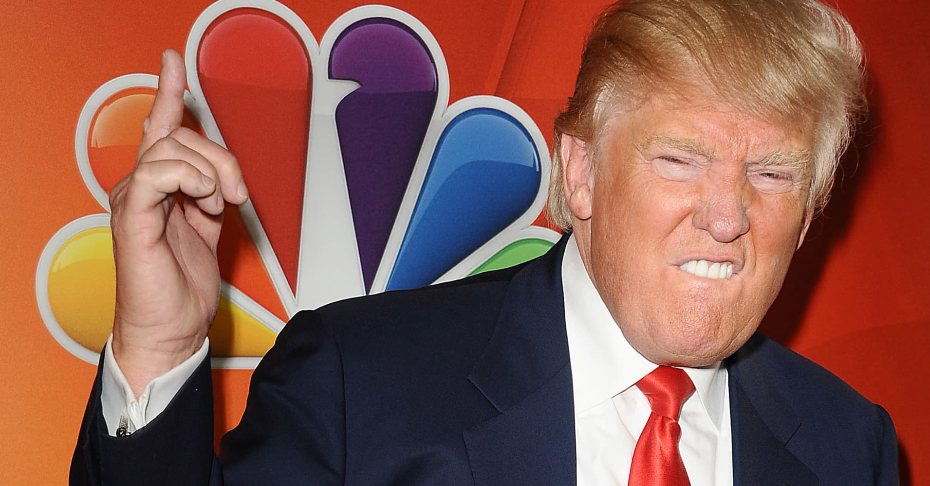 Trump threatens to 'challenge' NBC's license; Comcast shares dip slightly