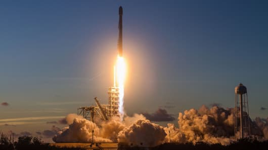 SpaceX's Falcon 9 rocket takes off on its mission to deliver the EchoStar 105/SES-11 satellite to space.