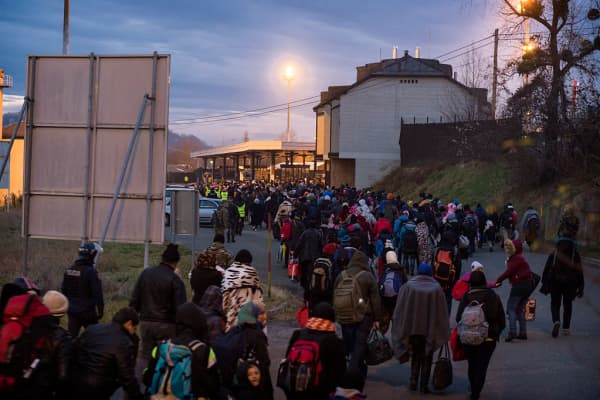 Migrants wait to be allowed to cross to Austria, in Sentilj, Slovenia. About 5,000 migrants are reaching Europe each day along the so-called Balkan migrant route, stoking tensions among the countries along the migrant corridor including Greece, Macedonia, Serbia, Croatia and Slovenia.