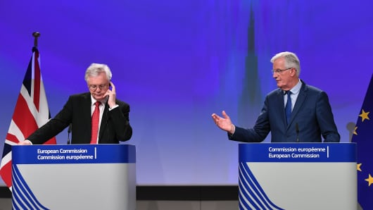 British Secretary of State for Exiting the European Union (Brexit Minister) David Davis (L) and European Union Chief Negotiator in charge of Brexit negotiations with Britain Michel Barnier address media representatives at the European Union Commission in Brussels on October 12, 2017.