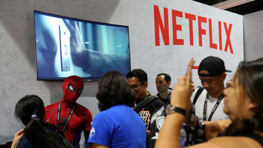 Fans gather at the Netflix booth at a trade show.