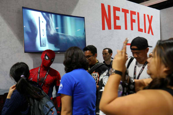 Comic con fans gather at the Netflix booth at Comic Con International in San Diego, California, July 19, 2017.