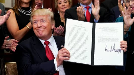 President Donald Trump smiles after signing an Executive Order regarding health insurance plans at the White House in Washington, October 12, 2017.