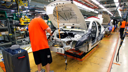 A General Motors' worker assembles a Cadillac ATS on the assembly line at the General Motors Lansing Grand River Assembly Plant.