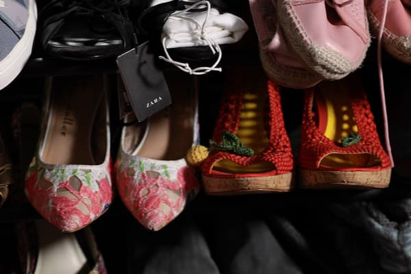 Some of the 1,500 items Gomez holds in her studio apartment are shoes she hopes to sell at a price three-times higher than what she paid for them.