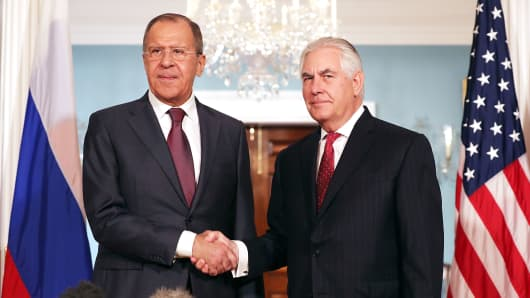 Russian Foreign Minister Sergey Lavrov (L) and U.S. Secretary of State Rex Tillerson shake hands in the Treaty Room before heading into meetings at the State Department May 10, 2017 in Washington, DC.