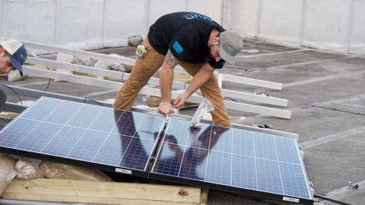 SunRun employees installing solar panels to help with the Puerto Rico relief effort.