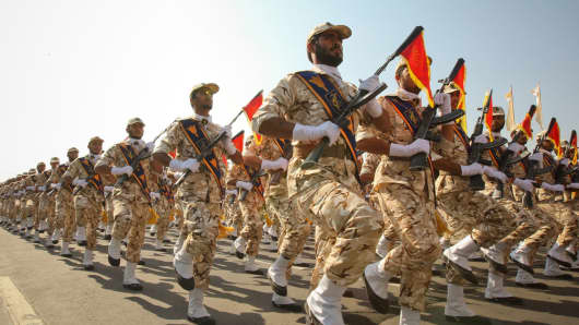 Members of the Iranian revolutionary guard march during a parade to commemorate the anniversary of the Iran Iraq war, in Tehran