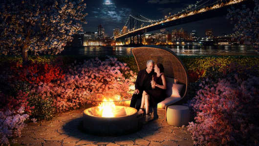 One of the many outdoor amenities at One Manhattan Square is a fire pit