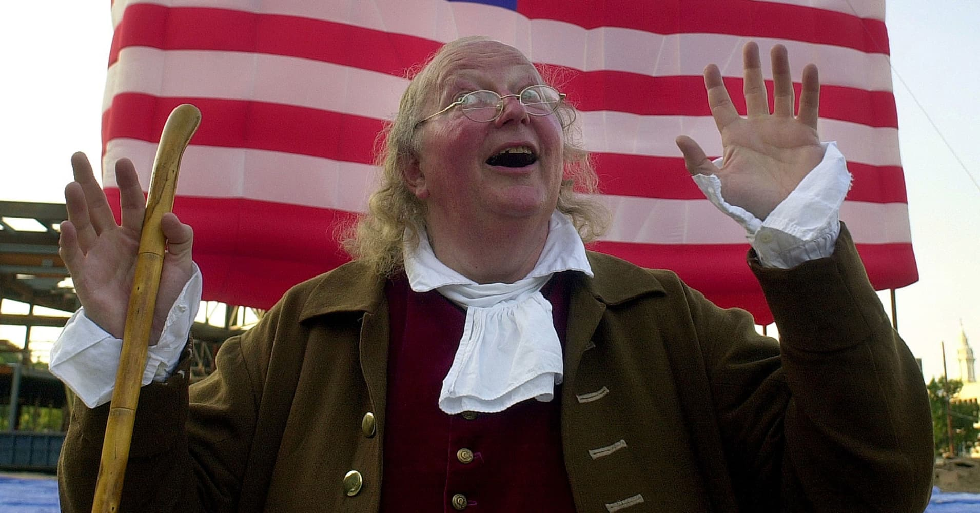 Actor Ralph Archibald, portraying Ben Franklin, reacts during the start of the one year countdown of the grand opening of the National Constitution Center (NCC) July 3, 2002, in Philadelphia, Pennsylvania.