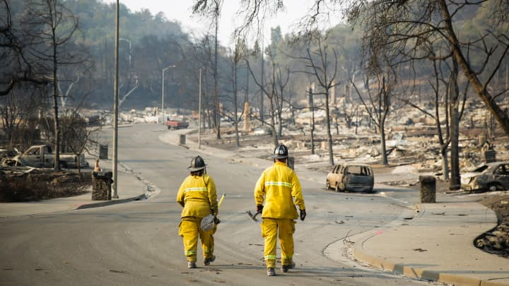 Firefighters walk through the Fountaingrove neighborhood on October 13, 2017 in Santa Rosa, California.