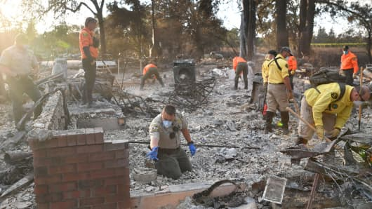 A search and rescue team searches for bodies in Santa Rosa, California on October 12, 2017 after the Tubbs Fire caused devastation.