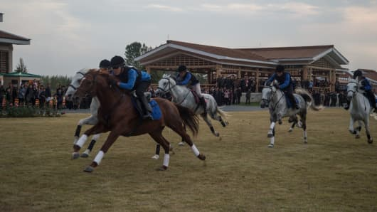 Amateur horse riders compete during the 'Autumn Race-Goers Games' at the Mirim Riding Club in Pyongyang on October 15, 2017.