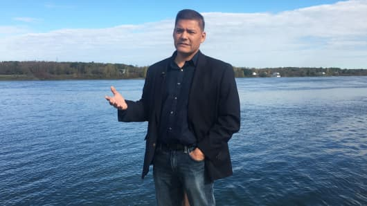 Saint Regis Mohawk Tribe Chief Eric Thompson next to the Saint Lawrence River in upstate New York. The tribe aims to diversify its economy through patent partnerships with technology companies.