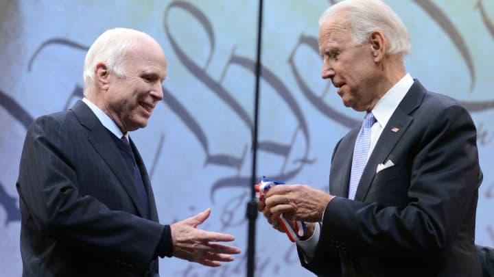 Sen. John McCain (R-AZ) receives the the 2017 Liberty Medal from former Vice President Joe Biden at the National Constitution Center on October 16, 2017 in Philadelphia, Pennsylvania.