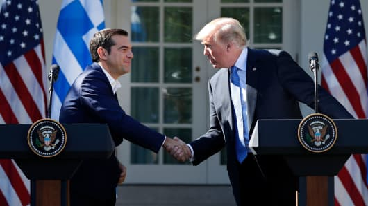 Greek Prime Minister Alexis Tsipras and U.S. President Donald Trump shake hands at the start of a joint press conference in the Rose Garden of the White House in Washington, U.S., October 17, 2017.