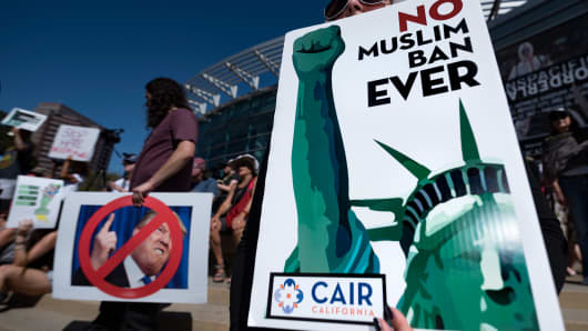 People take part in a protest against President Trump's travel ban, dubbed by activists as Muslim Ban 3.0, in Los Angeles, California on October 15, 2017.