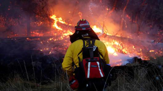 Firefighters battle a wildfire near Santa Rosa, California.