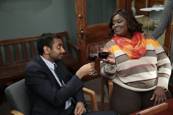 "Aziz Ansari as Tom Haverford and Retta as Donna Meagle on NBC's ""Parks and Recreation."""