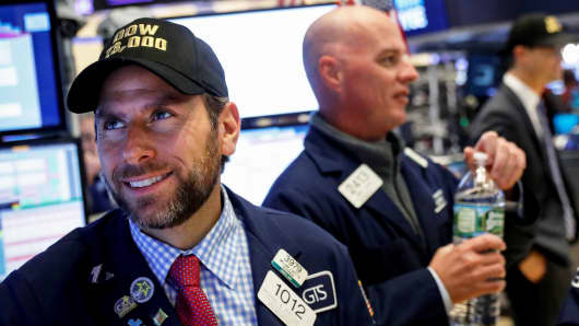 Specialist trader Michael Pistillo Jr. wears a dow 23,000 hat, after the dow briefly traded above 23,000, at his post on the floor of the New York Stock Exchange in New York, October 17, 2017.