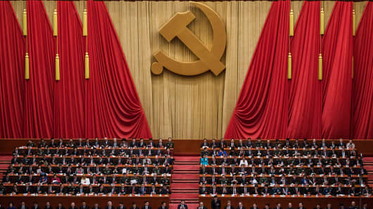 Chinese President Xi Jinping, bottom center, is applauded by senior members of the government after his speech at the opening session of the 19th Communist Party Congress held at The Great Hall Of The People on October 18, 2017 in Beijing, China.