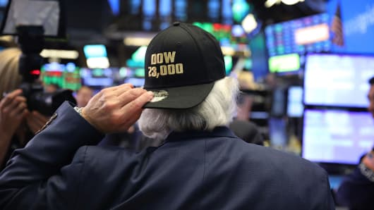 A trader wears a hat reading Dow 23,000 on the floor of the New York Stock Exchange (NYSE) on October 17, 2017 in New York City.