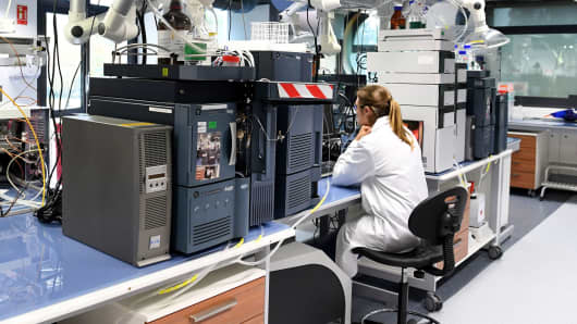 A woman works at Allergan's R&D and global production site in Pringy, France.