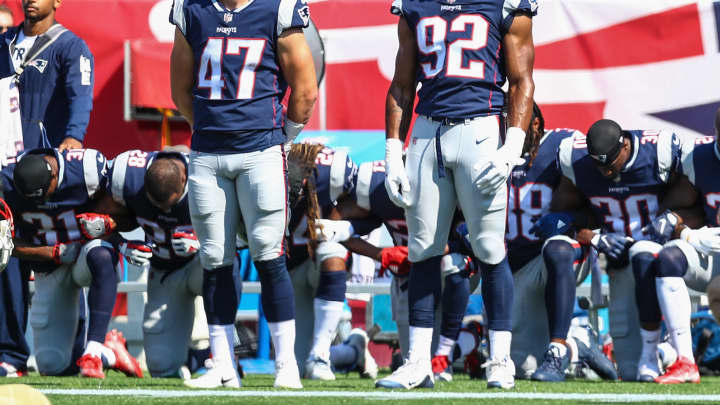 Members of the New England Patriots kneel on the sidelines during the National Anthem before a game against the Houston Texans at Gillette Stadium on September 24, 2017 in Foxboro, Massachusetts.