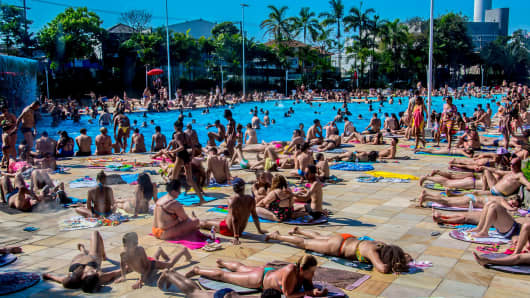 People cool off in swimming pools in São Paulo on a hot winter Sunday last month.