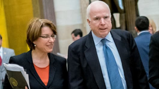 Senators Amy Klobuchar, D-MN and John McCain, R-AZ.