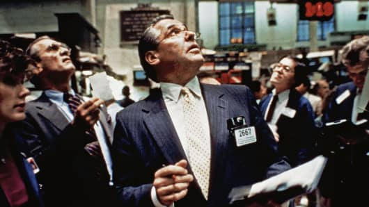 In this Oct. 19, 1987 file photo, traders on the floor of the New York Stock Exchange watch monitors for transactions.