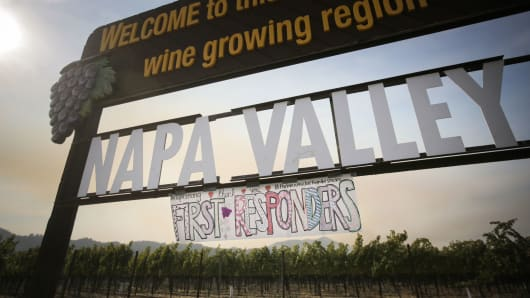 A handmade sign is seen attached to the Napa Valley welcome sign on October 16, 2017 in Oakville, California.