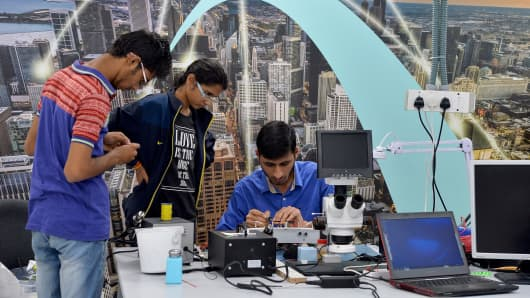 Interns at work at start-up company Hacklab.in in Bangalore. In the basement of a Bangalore building, hundreds of young Indians sit and type furiously, all dre