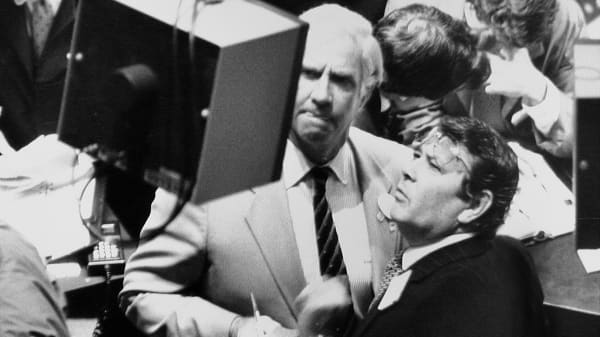 Traders look at stock prices on Black Monday, October 19, 1987 at the New York Stock Exchange.